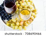 red and white wine in glasses... | Shutterstock . vector #708690466