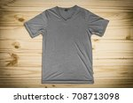 grey t shirt on wood background | Shutterstock . vector #708713098