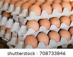 raw chicken eggs in egg box  | Shutterstock . vector #708733846