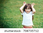 funny little girl showing... | Shutterstock . vector #708735712