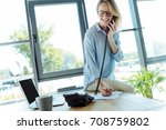 pleasant woman talking on phone ... | Shutterstock . vector #708759802