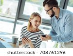 cheerful colleagues laughing... | Shutterstock . vector #708761296