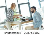 young woman explaining project... | Shutterstock . vector #708763102