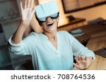 positive female playing virtual ... | Shutterstock . vector #708764536