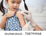 Doctor injecting vaccination in ...