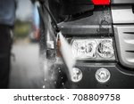 Manual Truck Washing Using High Pressured Hot Water with Detergents. Closeup Photo. - stock photo