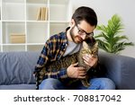 man with a cat | Shutterstock . vector #708817042