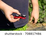 boy playing with two fidget... | Shutterstock . vector #708817486