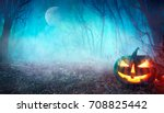 Stock photo halloween background spooky pumpkin with moon and dark forest halloween design with copyspace 708825442