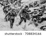 "Small photo of Battle remake with armed soldiers.The VIII International Festival of Military History and remake for the battle ""1944"" black and white 6.08.2016 in Valga, Estonia"