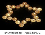 burning candles in the shape of ... | Shutterstock . vector #708858472