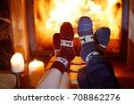 man and woman in warm socks... | Shutterstock . vector #708862276