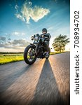 man riding sportster motorcycle ... | Shutterstock . vector #708934702