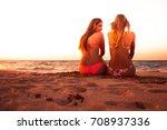 two sexy girls enjoying sitting ... | Shutterstock . vector #708937336