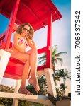 sexy blonde girl on lifeguard... | Shutterstock . vector #708937342