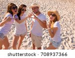 group of young boys enjoying on ... | Shutterstock . vector #708937366