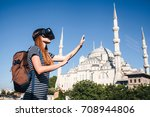 a traveler with virtual reality ... | Shutterstock . vector #708944806