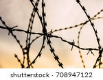 barb wire captivity prison... | Shutterstock . vector #708947122