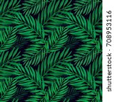 tropical palm leaves pattern.... | Shutterstock .eps vector #708953116