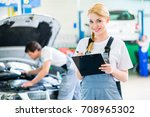 male and female mechanic team... | Shutterstock . vector #708965302