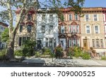 a row of historic brick... | Shutterstock . vector #709000525