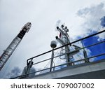 Small photo of View of a vessel masthead with background of cloudy blue skies.