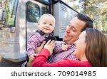 happy young caucasian family in ... | Shutterstock . vector #709014985