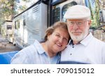 senior couple in front of their ... | Shutterstock . vector #709015012