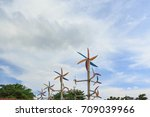 windmill around trees with blue ... | Shutterstock . vector #709039966