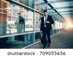 businessman walking with... | Shutterstock . vector #709055656