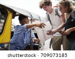 tourists couple asking tuk tuk... | Shutterstock . vector #709073185