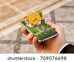 Small photo of Smartphone application for online searching, buying, selling and booking real estate. Unusual 3D illustration of beautiful house on smartphone in hand