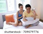 young vietnamese couple using... | Shutterstock . vector #709079776
