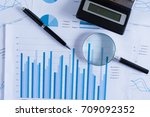 many charts and graphs with... | Shutterstock . vector #709092352