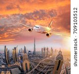 airplane is flying over dubai... | Shutterstock . vector #709103512