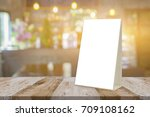 empty brown wooden table and... | Shutterstock . vector #709108162