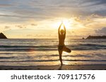 caucasian woman practicing yoga ... | Shutterstock . vector #709117576
