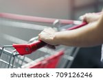 woman with empty trolley car is ...   Shutterstock . vector #709126246
