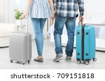 Stock photo young couple with luggage in hotel room 709151818