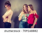 woman being bullied by her two... | Shutterstock . vector #709168882
