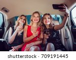 women drinking champagne and... | Shutterstock . vector #709191445