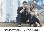 asian business man and woman... | Shutterstock . vector #709200808