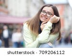 beautiful girl sitting on... | Shutterstock . vector #709206112
