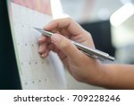 close up on woman hand with pen ...   Shutterstock . vector #709228246