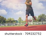 man running in the track. fit... | Shutterstock . vector #709232752
