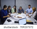 male and female professionals... | Shutterstock . vector #709237372