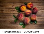 peaches on a wooden background | Shutterstock . vector #709259395