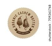 cashew butter emblem with hand... | Shutterstock .eps vector #709261768