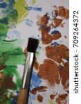 Small photo of Colorful daub and a brush for drawing