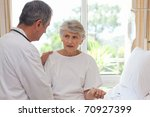 doctor with his patient | Shutterstock . vector #70927399